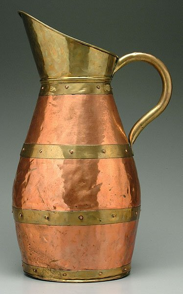 607: Copper and brass pitcher,