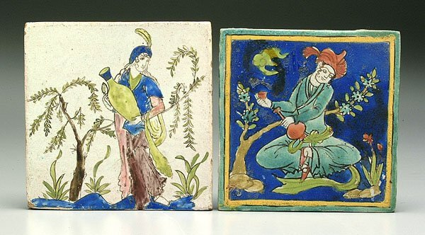 609: Two decorated tiles,