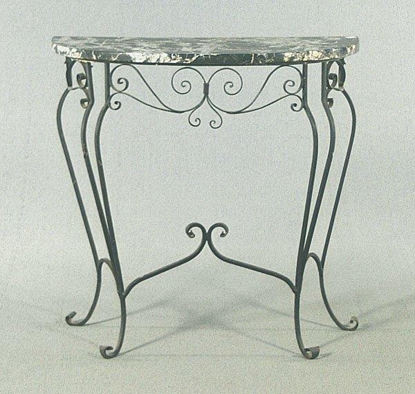 621: Demilune iron console,