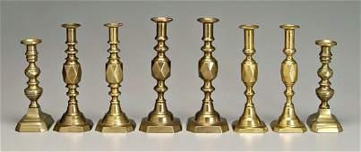 9: Four pairs brass candlesticks: