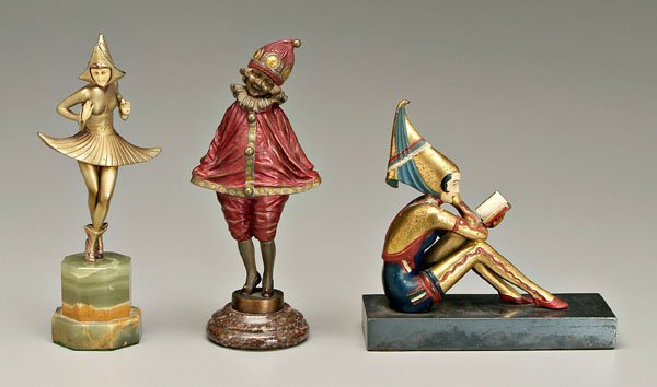 576: Three Art Deco style sculptures: