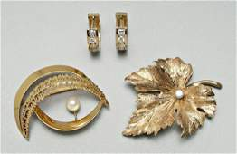 855: Four pieces 14 kt. gold jewelry: