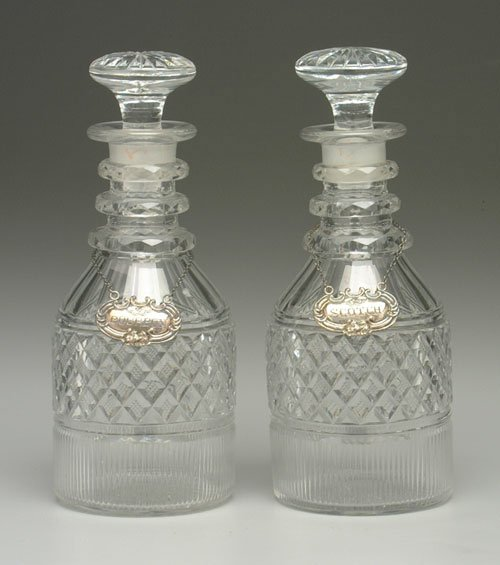 606: Pair cut glass decanters, matching stopp