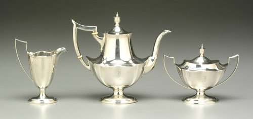 609: Three-piece sterling silver tea service: