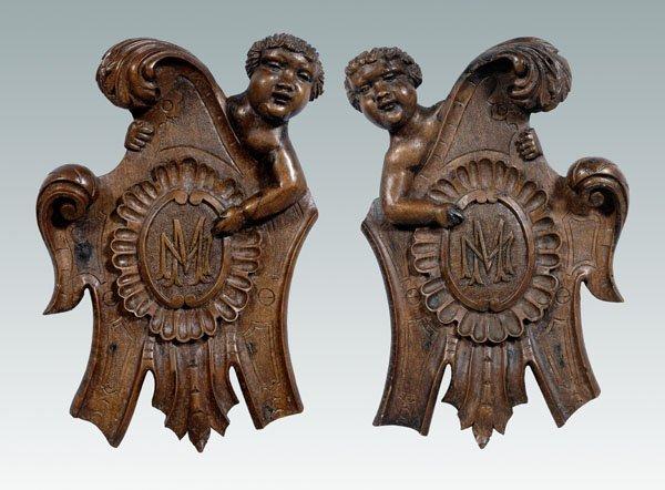 16: Pair carved cherub plaques: