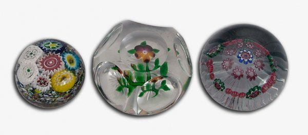 17: Three floral paperweights: