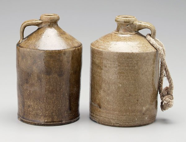 90: Two Timmerman stoneware whiskey jugs,