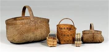 255: Five oak split baskets: