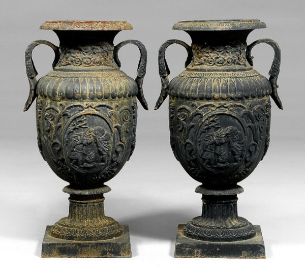 542: Pair large cast iron garden urns: