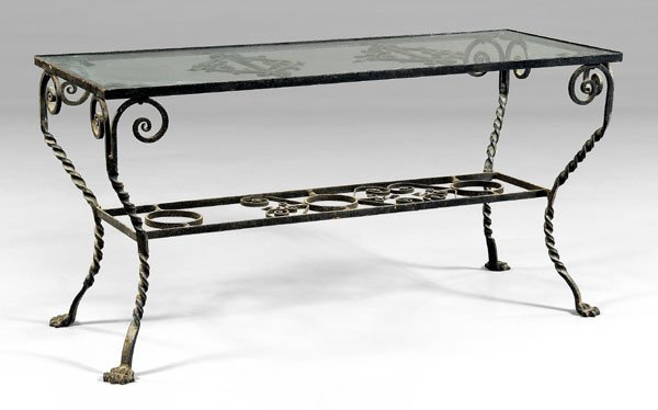 549: Wrought iron and glass garden table,