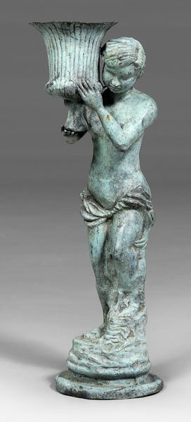 557: Patinated metal garden figure,