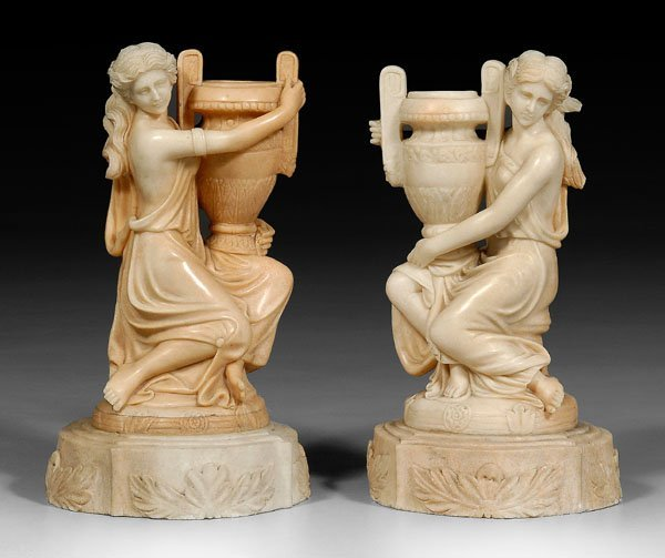 17: Pair of carved marble figural urns: