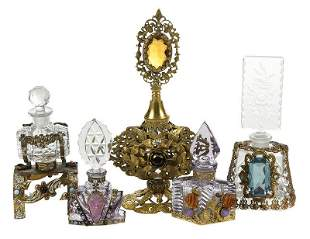 Five Gilt Filigree and Jeweled Perfume Bottles