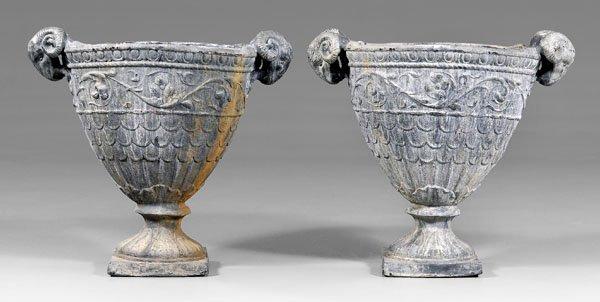 585: Fine pair lead garden urns: