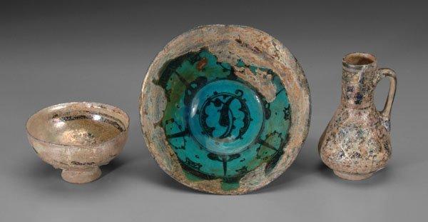 601: Three Persian pottery items,