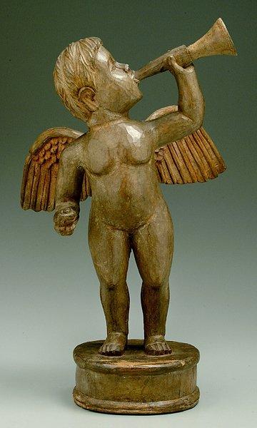 12: Carved wood figural cherub,