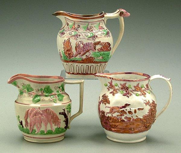 22: Three figured pearlware luster jugs: