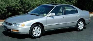 292: Silver 1996 four-door Honda Accord,