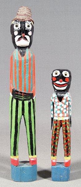 449: Homer Green folk art carved figures,