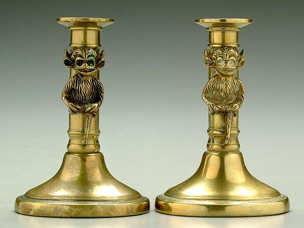 603: Pair brass demon candlesticks: