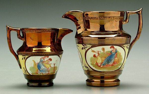 612: Two copper luster pitchers,