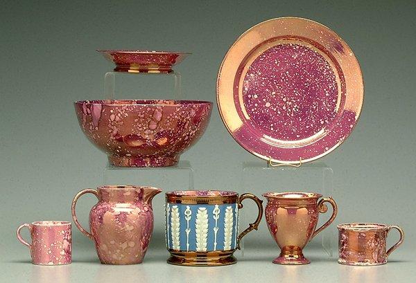 617: Eight pieces pink-splashed lusterware: