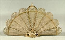 628: Folding brass fan fire screen,