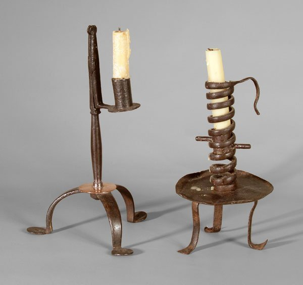 18: Two early wrought iron candlesticks: