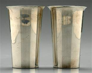 Eight sterling tumblers,