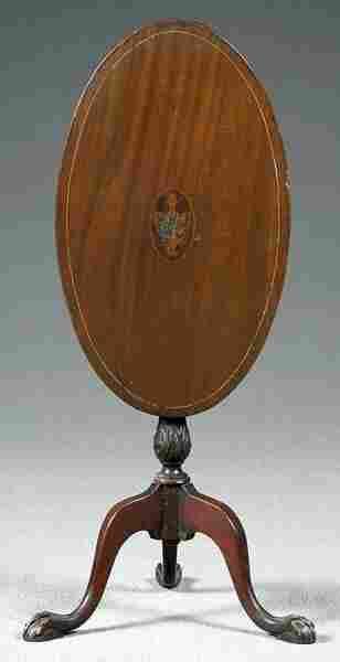 Inlaid tilt-top oval mahogany table,