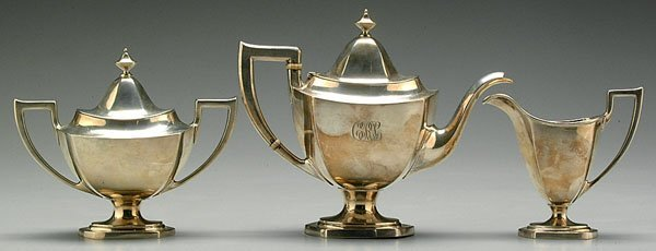 22: Three-piece sterling tea service: