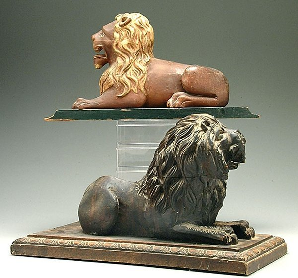 615: Two carved wood lions: