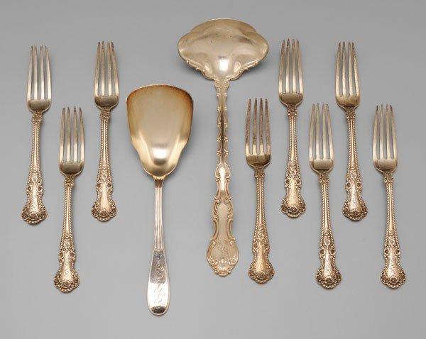 1039: Ten Pieces Silver Flatware