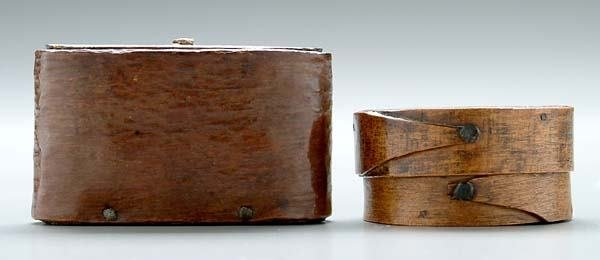 562: Two lidded wooden boxes: