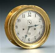 310: Brass key-wind ship's clock,