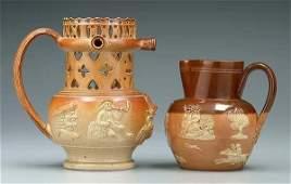 34: Stoneware puzzle jug, Doulton jug: