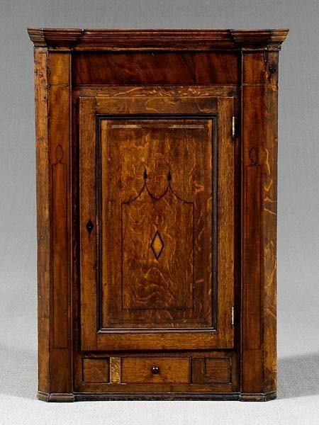 21: Inlaid English oak corner cabinet,