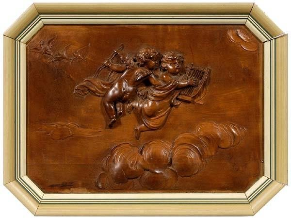 20: 19th century carved fruitwood panel,