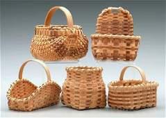 692: Five miniature oak split baskets: