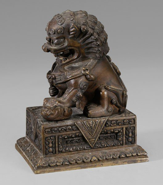 5: Bronze Buddhist Lion on Stand