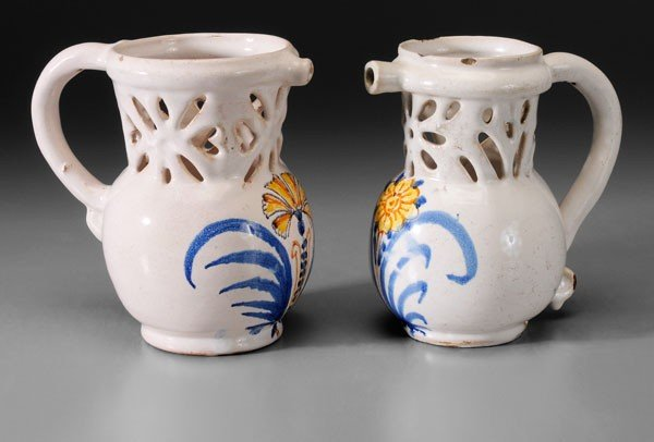 650: Two Faience Puzzle Jugs