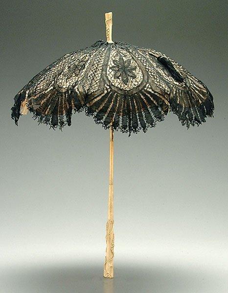 17: Ivory-handled parasol,