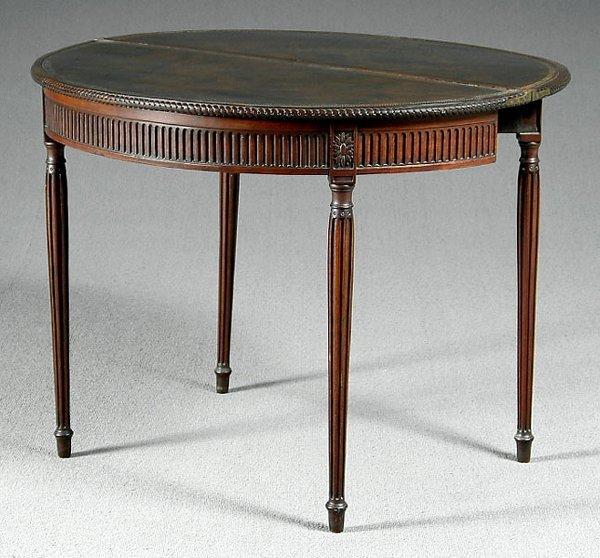 517: English mahogany demilune games table,