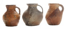 Three Early Earthenware Pitchers