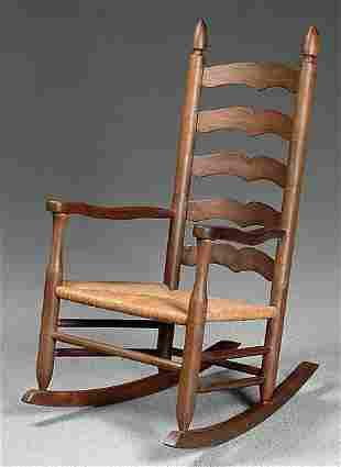 Walnut ladder back rocking chair,