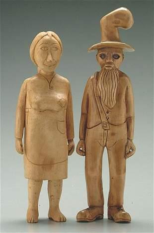 Pair carved folk art figures