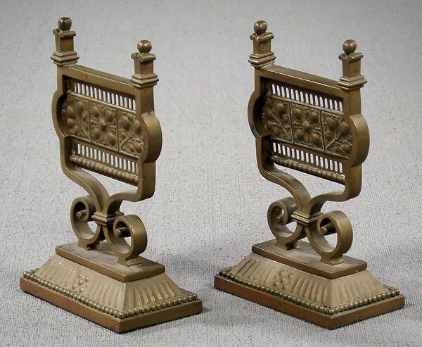 610: Pair lyre form brass tool rests,