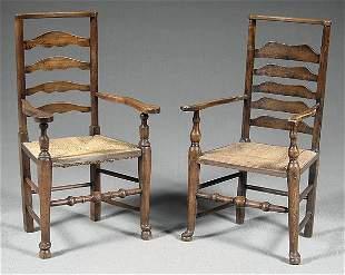 Two similar English armchairs,