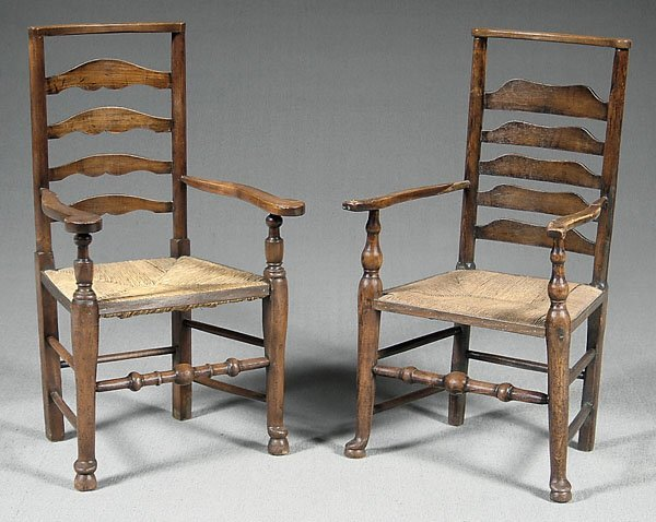 617: Two similar English  armchairs,