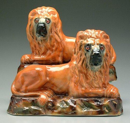 6: Pair ceramic recumbent lions, possibly Sta